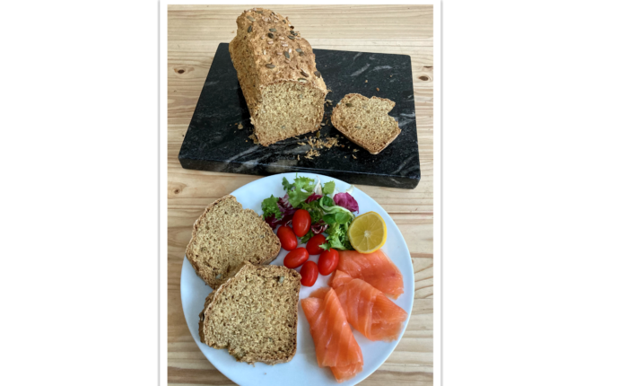 Irish Soda Bread slices served on a place with with smoked salmon and salad.